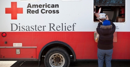 Image: A woman receives warm meals from a Disaster Relief truck run by the American Red Cross in the Midland Beach neighborhood in Staten Island