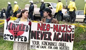 blog protesters hold anti nazi signs